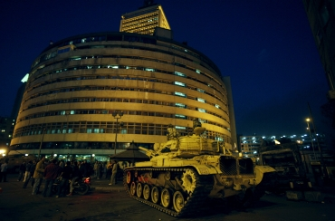 A military tank sits next to the Egyptian state television building in Cairo
