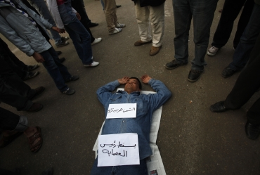 A protester sleeps at Tahrir Square in Cairo