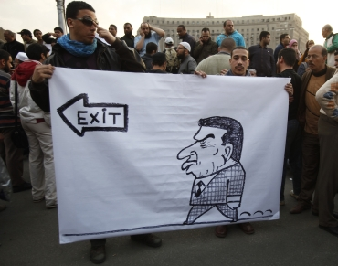 Protesters hold a banner against President Hosni Mubarak during a demonstration in Cairo