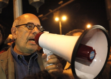 Egyptian opposition leader Mohamed ElBaradei speaks to protesters at Tahrir Square in Cairo
