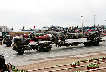 Pakistani military trucks carry the long range nuclear-capable surface-to-surface Ghauri ballistic missile during the National Day parade