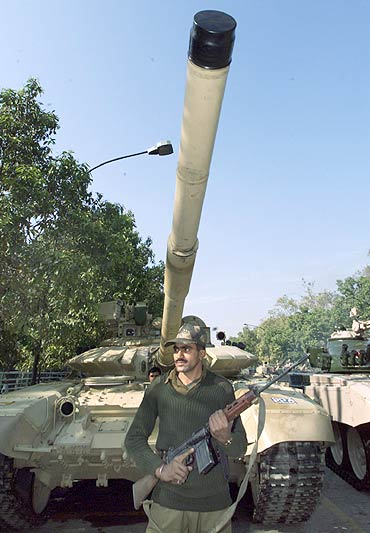 Indian soldier stands in front of the T-90 battle tank