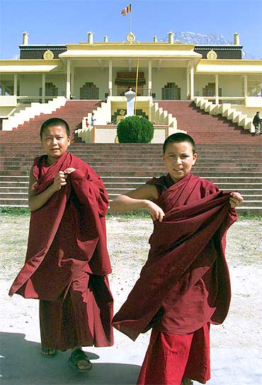 Tibetan children walk in front of Gyuto Monastery in Dharamsala