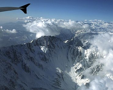 The snow-covered Pir Panjal mountain range in Kashmir is seen from the window of a passenger airplane January 9, 2011