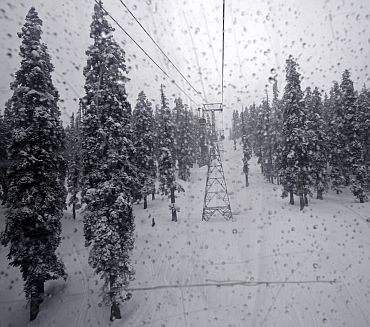 A picture taken from inside the cabin of a gondola shows the snow-covered trees in Gulmarg, 55km west of Srinagar