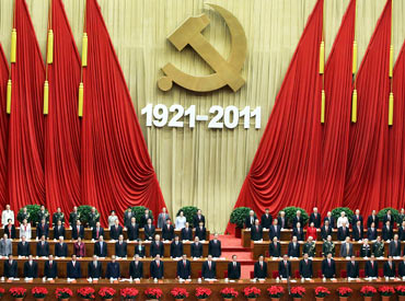 Members of the Communist Party stand and sing the song Internationale during the celebration of CPC's 90th anniversary at the Great Hall of the People on Friday in Beijing.