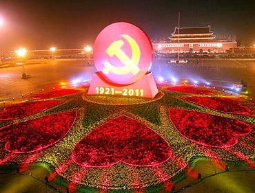A huge emblem of the CPC is seen at Tian'anmen Square in Beijing
