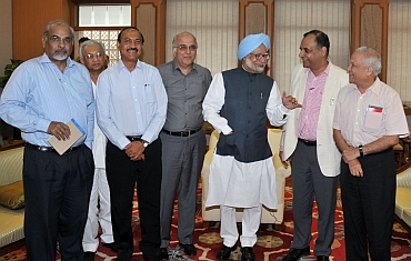 Dr Singh shares a light moment with senior editors in New Delhi