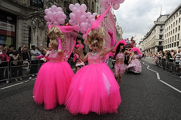Participants take part in the annual Pride London parade
