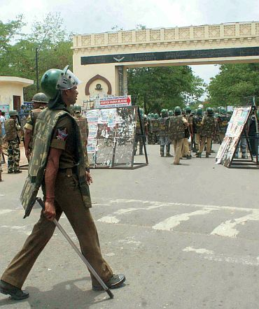 Riot-police outside the Osmania University campus