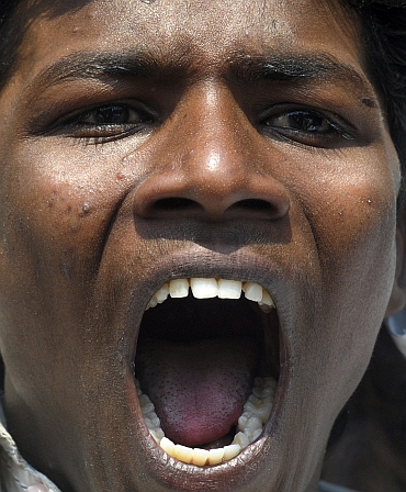 A pro-Telangana supporter shouts slogans during a demonstration in Hyderabad
