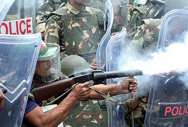 RAF personnel fire tear gas at students of Osmania University