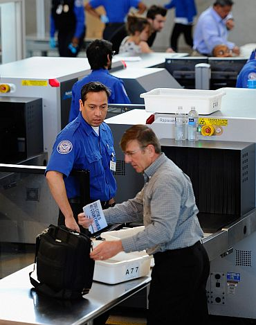 Transportation Security Administration agents screen passengers at Los Angeles International Airport on May 2