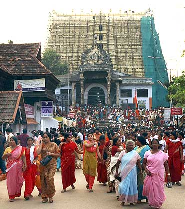 Devotees leave Sree Padmanabhaswamy temple after offering prayers on the eve of Pongala festival in Thiruva