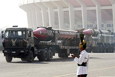 Pakistan's nuclear-capable missile Ghauri is driven past with its mobile launcher during the National Day military parade in Islamabad