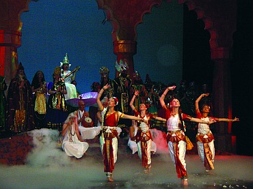 Students performing an invocation dance in front of the Goddess Saraswati