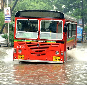 A BEST bus makes its way through a flooded street at Sion
