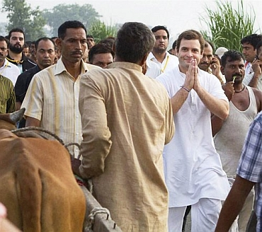 Rahul Gandhi interacts with a farmer during the padyatra