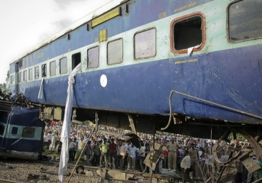 People gather around the mangled carriages of Kalka Mail