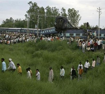 People search the mangled carriages of the Kalka Mail train which derailed near Fatehpur