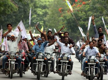 Students raise slogans in support of a separate state of Telangana