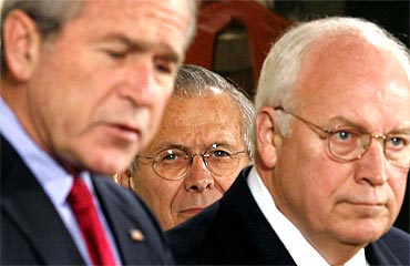 US President George W Bush with Secretary of Defence Donald Rumsfeld and Vice President Dick Cheney