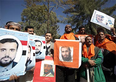 Al Jazeera cameraman and former Guantanamo detainee Sami al-Haj takes part in a protest by relatives of Guantanamo detainees