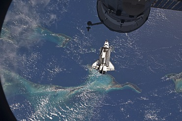 Atlantis is seen over the Bahamas prior to docking with the International Space Station in this photo provided by NASA