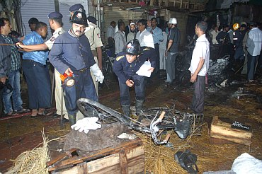 Fire brigade personnel at the blast site at Zaveri Bazaar