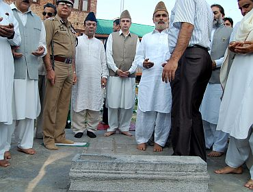Jammu and Kashmir CM Omar Abdullah pays tribute in the martyr's graveyard in Srinagar on Wednesday
