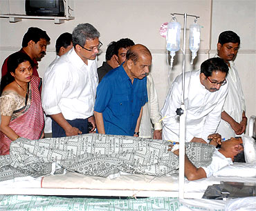 Shiv Sena leader Uddhav Thackeray visits the injured victims at the hospital