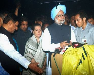 Prime Minister Manmohan Singh speaks to reporters at JJ Hospital in Mumbai.