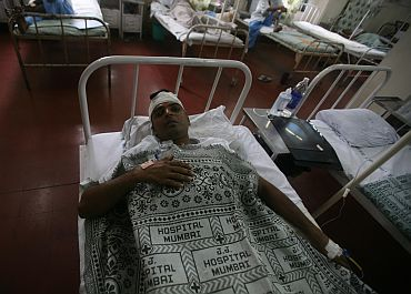 A blast victim at Mumbai's JJ Hospital, a day after the triple blasts, on Thursday.