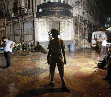 A policeman stands guard at Zaveri Bazaar in Mumbai
