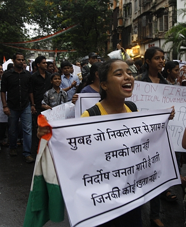 A student participates in a protest march in Mumbai on Saturday