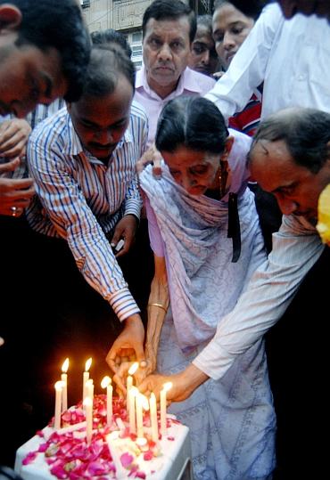 An aged Mumbaikar participates in a candlelight vigil