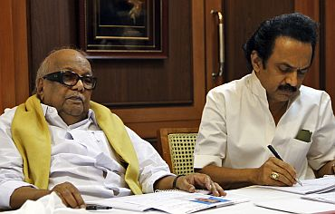 DMK chief M Karunanidhi with former deputy CM M K Stalin at the party headquarters in Chennai