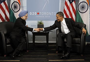 US President Barack Obama shakes hands with PM Singh during their bilateral meeting in Toronto