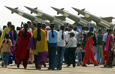 People look at missiles during an air show in Chandigarh
