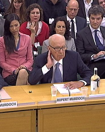 BSkyB Chairman James Murdoch and News Corp Chief Executive and Chairman Rupert Murdoch appear before a parliamentary committee on phone hacking at Portcullis House in London