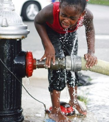 Makayla Martin, 9, cools off at a fire hydrant in St Louis, Missouri, US. The area has been under a heat advisory as temperatures hit 100 degrees Fahrenheit (38 degrees Celsius)