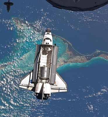 Space shuttle Atlantis is seen over the Bahamas