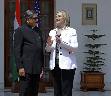 US Secretary of State Hillary Clinton speaks with External Affairs Minister SM Krishna during a photo call before their meeting in New Delhi