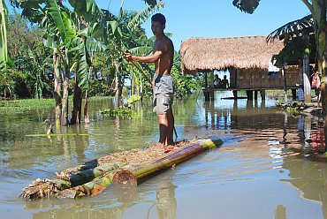A villager on a makeshift boat in Lakhimpur