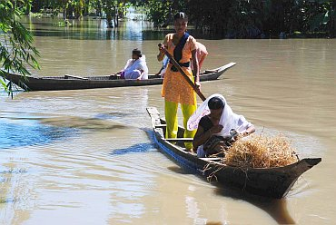 Villagers using boats to move around, in Lakhimpur