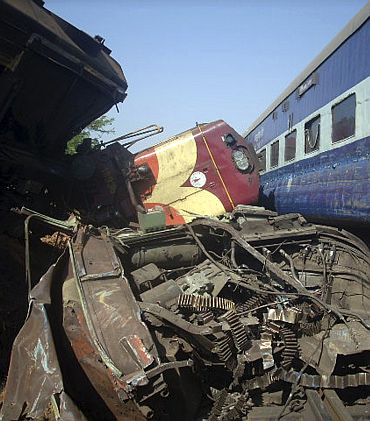 Damaged trains are seen at the site of an accident in Bolangir district of Orissa May 4. At least 26 passengers were injured in the mishap.