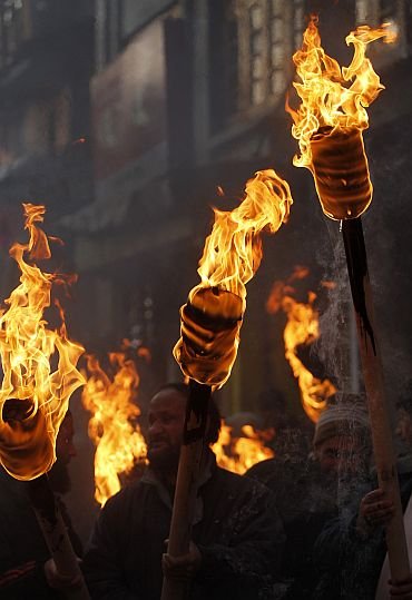 Kashmiri separatists hold torches to mark International Human Rights Day in Srinagar
