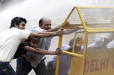 BJP supporters clash with the police during an anti-corruption agitation in New Delhi