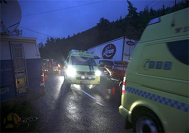 Ambulances are seen on Utoeya island after a shooting took place at a meeting of the ruling party