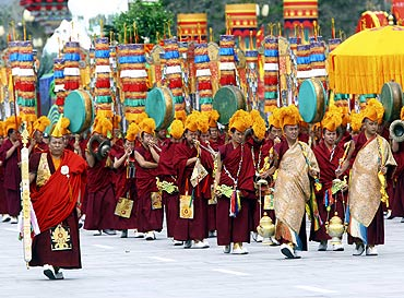 Tibetan buddhists take part in a parade celebrating the 60th anniversary of Tibet's peaceful liberation in front of the Potala Palace in Lhasa